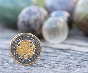 astromedal mixta oro y plata