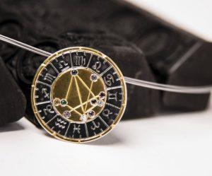 astromedal oro y plata mixto broche y colgante