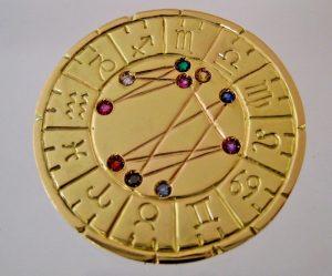 astromedal oro colgante